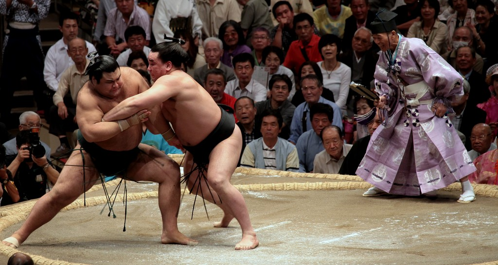 Sumo bout initial charge wrestlers jump Tokyo Japan