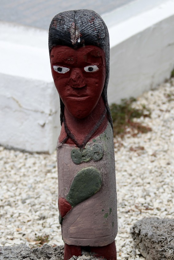 ugly moari statue in village new zealand north island