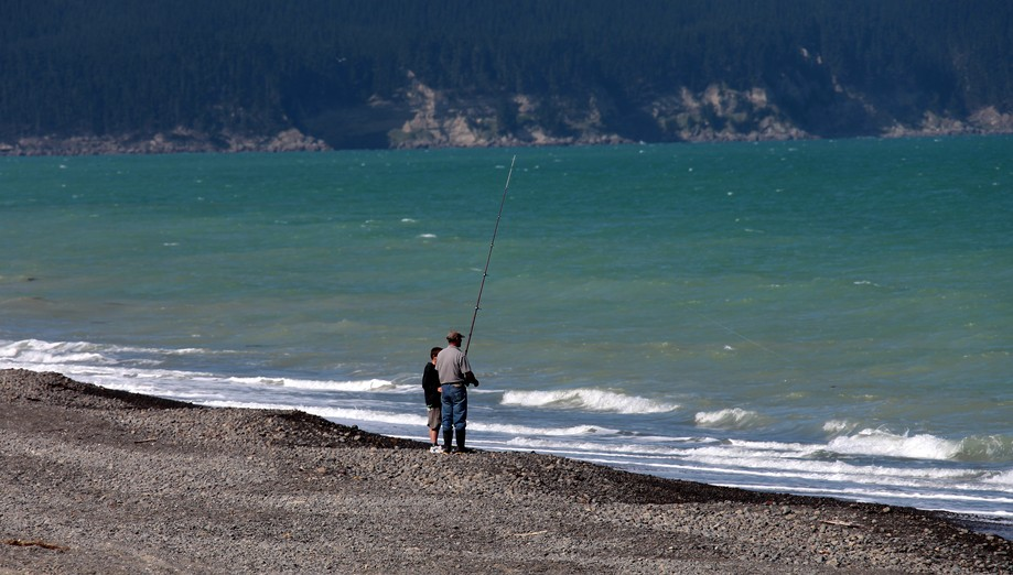 father and son fishing in new zealand south island