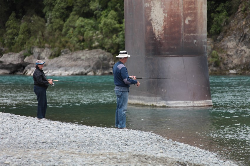 couple fishing in the river new zealand south island