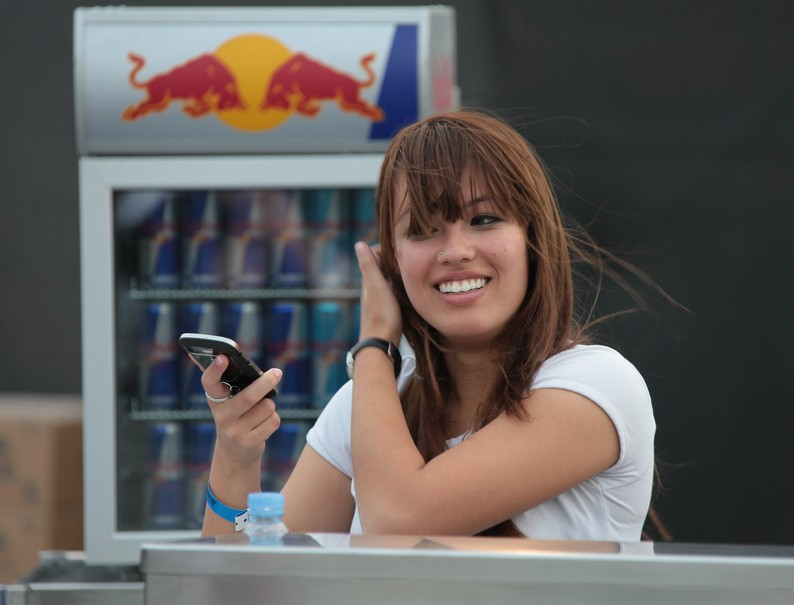 Red Bull smiling hostess sporting events and sponsorship