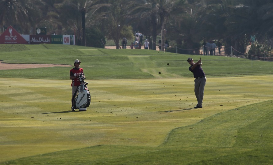 Caddy is a person who carries a player's bag and clubs