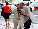 Female reporter Japanese girl tv typhoon Man-Yi Japan Tokyo Shinjuku quarter